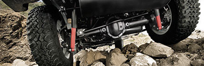Rubicon® models offer a Rock-Trac® transfer case and features a 4:1 low-range, Tru-Lok® locking differentials and Dana® 44 heavy-duty front and rear solid axles.
